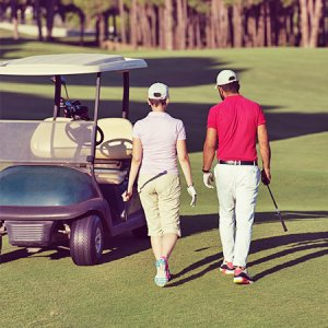 two golfers walking toward their golf cart